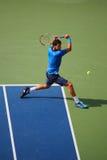 Yrkesmässig tennisspelare Grigor Dimitrov från Bulgarien under match för runda 4 för US Open 2014 Arkivfoto