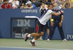 Yrkesmässig tennisspelare Janko Tipsarevic under den fjärde runda matchen på US Open 2013 mot David Ferrer Arkivfoton