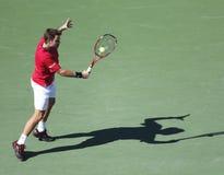 Yrkesmässig tennisspelare Stanislas Wawrinka under kvartsfinalmatch på US Open 2013 mot Andy Murray Arkivfoton