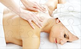 Yrkesmässigt massagepussel Arkivfoto