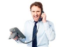 Yrkesmässigt skrika för ilsken affär Arkivfoton