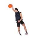 Yrkesmässig basketspelare som kastar klumpa ihop sig Fotografering för Bildbyråer