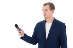 Yrkesmässig manlig reporter som rymmer en mikrofon isolerad på whit Arkivbilder