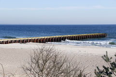 Ystad Beach. Bridge into the Baltic, on a Beach near the city of Ystad in Southern Sweden Royalty Free Stock Photos