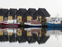 Ystad Habor, Skane, Sweden. Fishing lodges, boats and reflections in water. Ystad Habor, Skane, Sweden Royalty Free Stock Image