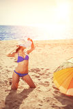 YSummer holiday, girl traveling, relax on the beach on a backgro. Summer holiday, girl traveling, relax on the beach on a background of water. Fun summer party Royalty Free Stock Photography