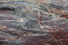 Yttersida av den naturliga röda stenen som bakgrund Arkivfoto