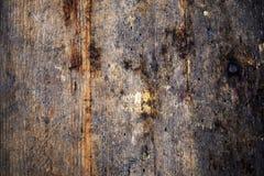 Yttersida av det gamla träskrivbordet med maskhålet royaltyfri foto
