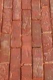 yttersida av en gammal röd tegelsten. Arkivfoto