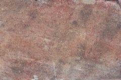Yttersida av naturligt mörker - röd sten som bakgrund Arkivbilder