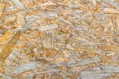 Yttersida av OSB-plattacloseupen naturligt texturträ för abstrakt bakgrund abstrakt bakgrund Royaltyfri Foto