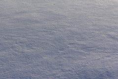Yttersida av snö med textur för bruk arkivbild