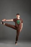 Ytthata hasta padangyshthasana 2 yoga. Beautiful man doing yoga on a white background Stock Images
