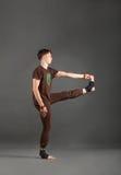 Ytthata hasta padangyshthasana 1 yoga. Beautiful man doing yoga on a white background Stock Photography