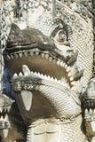 Yttre detalj av nagaen (mytologisk jätte- orm) på den 15th århundradePrasat templet i Chiang Mai, Thailand Fotografering för Bildbyråer