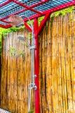 Yttre head dusch med bambubakgrund Arkivbild