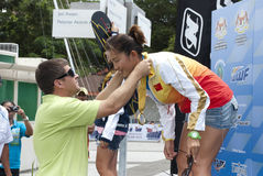 Yu Fei Song receiving medal. PUTRAJAYA, MALAYSIA - OCTOBER 9: Yu Fei Song from China wins the gold medal at 2011 IWWF Asian Waterski & Wakeboard Championships in Stock Photo