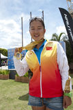 Yu Fei Song showing her medal. PUTRAJAYA, MALAYSIA - OCTOBER 9: Yu Fei Song from China wins the gold medal at 2011 IWWF Asian Waterski & Wakeboard Championships Stock Images