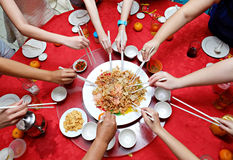 Yu Sheng Spring Toss also known by 2015 Yee Sang Prosperity Toss is a Chinese New Year Dish Royalty Free Stock Image