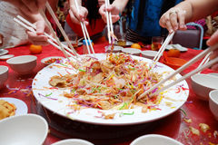 Yu Sheng Spring Toss also known by 2015 Yee Sang Prosperity Toss is a Chinese New Year Dish Stock Image