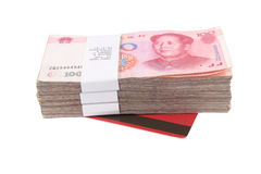 Yuan and bank book. A stack of chinese money and deposit book with white background Royalty Free Stock Photo