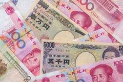 Yuan chinês com iene japonês Fotos de Stock
