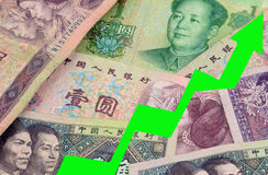 YUAN Chinese Currency RISING Stock Photo
