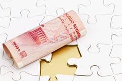 Yuan cinesi sul puzzle con il pezzo mancante Fotografia Stock