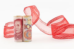 Yuan currency with red ribbon Royalty Free Stock Images
