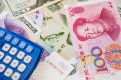 Yuan et chinois dollar US Photos stock