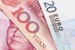 Yuan and Euro. Currency closeup on white background royalty free stock images