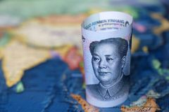 Yuan on the map of SouthEast Asia and Indonesia. Concept for chinese and asian economy, tourism, investment and trading stock photography