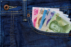 Yuan or RMB in Jean's pocket, Chinese Currency Royalty Free Stock Photos