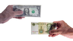 Yuan and us dollar in hand Stock Images
