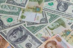 Yuan y dólar Fotos de archivo libres de regalías