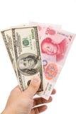 Yuan y dólar chinos Imágenes de archivo libres de regalías