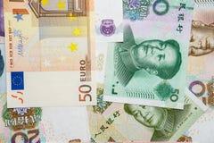 Yuan y EURO chinos Fotos de archivo