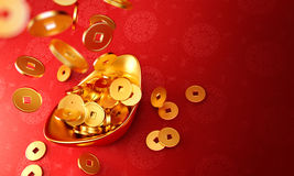 Yuanbao - Gold coins dropping on gold sycee Royalty Free Stock Images
