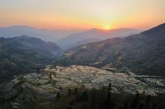 yuanyang de terrasse de coucher du soleil de riz Photos libres de droits
