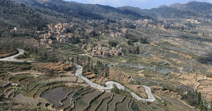 YuanYang ris terrasserar i Yunnan, Kina, en av de senaste UNESCOvärldsarven Arkivbilder