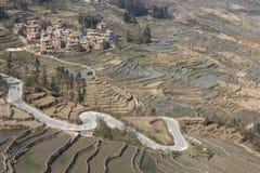 YuanYang ris terrasserar i Yunnan, Kina, en av de senaste UNESCOvärldsarven Arkivfoton