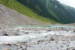 YUBENG CHINY, Aug, - 9 2014: Lodowy jezioro przy Yubeng wioską sławny Zdjęcie Royalty Free