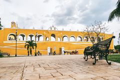 YUCATAN, MEXICO - MAY 31, 2015: Facade of the church view from the park royalty free stock photo