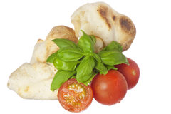 Yucca bread, tomatoes and basil Royalty Free Stock Photography