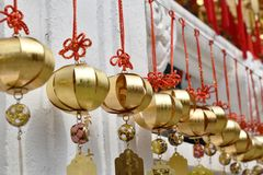 Golden bell donation and writing name for luck hanging on wall in Xuanguang Temple sun moon lake stock image