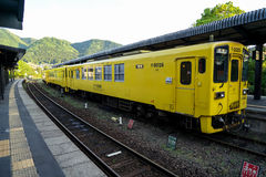 Yufuin, Japan - May 13, 2017 :Yellow color vintage train diesel car of JR Kyushu Railway Company stopped on rail at train station Royalty Free Stock Photos