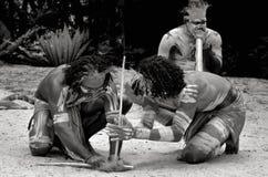 Yugambeh Aboriginal warriors men demonstrate fire making craft. During Aboriginal culture show in Queensland, Australia stock photos