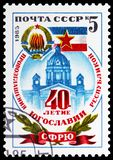 Yugoslav flag, coat of arms and Parlament building, 40th Anniversary of Republic of Yugoslavia serie, circa 1985. MOSCOW, RUSSIA - MAY 25, 2019: Postage stamp royalty free stock image