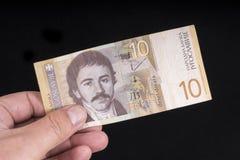 An Yugoslavian banknote. A Yugoslavian 10 Dinars banknote on the hand Stock Photography
