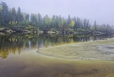 Yugra, a misty morning on the bank of the taiga river Royalty Free Stock Photography